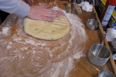 Degassing the dough.